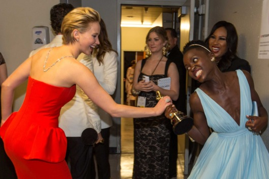 Actresses Jennifer Lawrence (L) and Lupita Nyong'o backstage during the Oscars held at Dolby Theatre on March 2, 2014 in Hollywood, California.