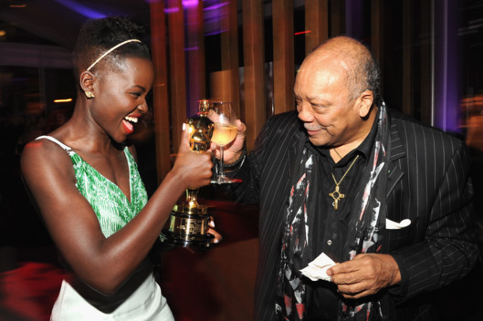 WEST HOLLYWOOD, CA - MARCH 02:  (EXCLUSIVE ACCESS, SPECIAL RATES APPLY) Lupita Nyong'o and Quincy Jones attend the 2014 Vanity Fair Oscar Party Hosted By Graydon Carter on March 2, 2014 in West Hollywood, California.  (Photo by Kevin Mazur/VF14/WireImage)