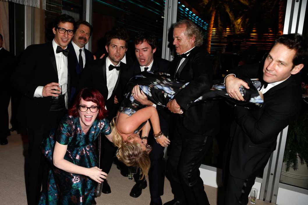 WEST HOLLYWOOD, CA - MARCH 02:  (EXCLUSIVE ACCESS, SPECIAL RATES APPLY) (L-R) Actors Andy Samberg, Nick Offerman, Megan Mullally (crouching), Adam Scott, Amy Poehler (being held upside-down), Bill Hader, Bill Murray, and Paul Rudd attend the 2014 Vanity Fair Oscar Party Hosted By Graydon Carter on March 2, 2014 in West Hollywood, California.  (Photo by Jeff Vespa/VF14/WireImage)