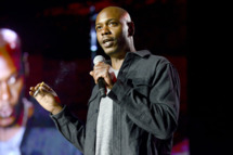 MOUNTAIN VIEW, CA - SEPTEMBER 20: Dave Chappelle performs as part of the The Oddball Comedy & Curiosity Festival at Shoreline Amphitheatre on September 20, 2013 in Mountain View, California. (Photo by Tim Mosenfelder/Getty Images)