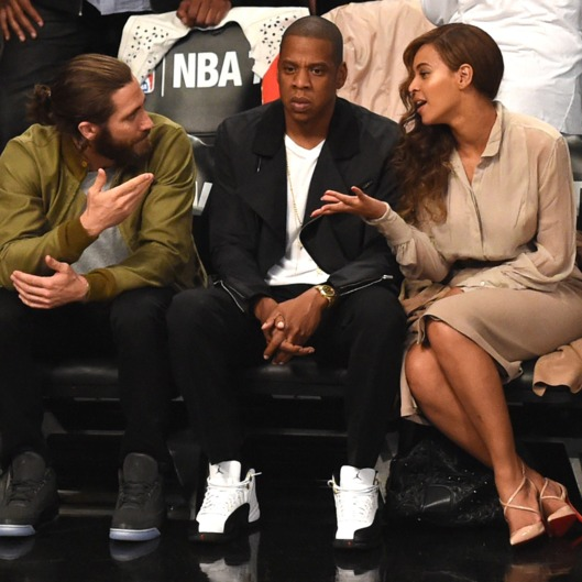 Jake Gyllenhaal (L), Jay Z (C) and Beyonce (R) watch the Miami Heat against the Brooklyn Nets  during Game 3 of their NBA Eastern Conference Semifinal at the Barclays Center on May 10, 2014.