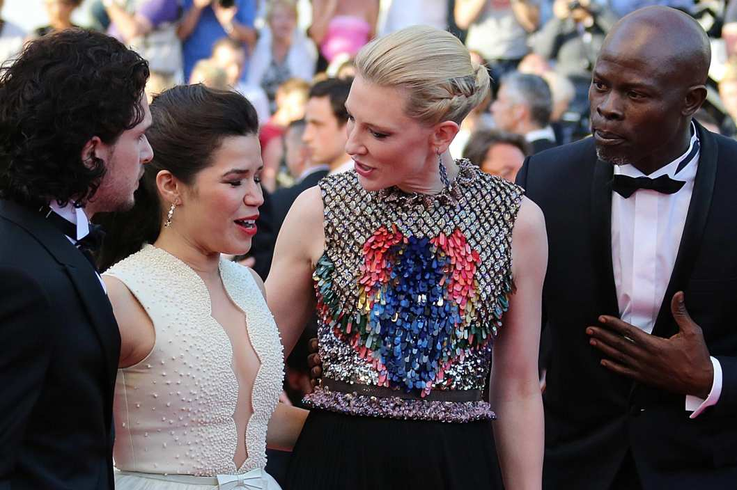 "US actress America Ferrera (2ndL) reacts, surrounded by British actor Kit Harington (L), Australian actress Cate Blanchett (2ndR) and Benin's actor Djimon Hounsou, after an unidentified man tried to slip under her dress as she was arriving for the screening of the animated film ""How to train your Dragon 2"" at the 67th edition of the Cannes Film Festival in Cannes, southern France, on May 16, 2014."