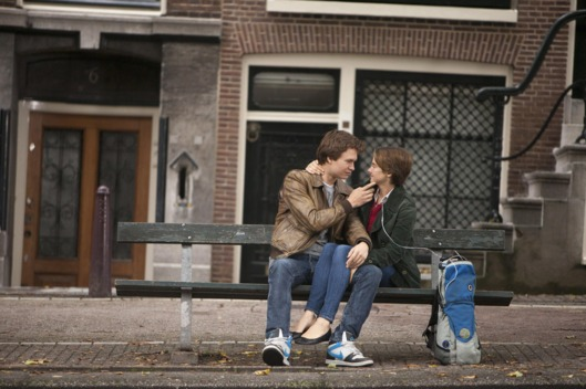 DF-18655 Hazel (Shailene Woodley) and Gus (Ansel Elgort) share a tender moment during a memorable trip to Amsterdam.