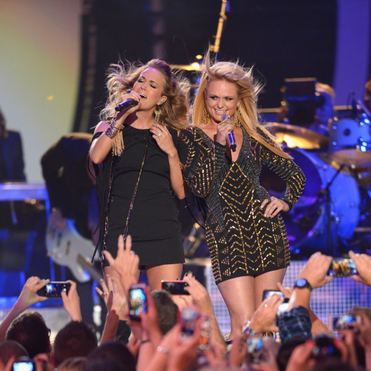 NASHVILLE, TN - JUNE 04:  Carrie Underwood and Miranda Lambert perform onstage at the 2014 CMT Music Awards at Bridgestone Arena on June 4, 2014 in Nashville, Tennessee.  (Photo by Michael Loccisano/Getty Images for CMT)