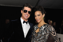 Recording artist Robin Thicke (L) and actress Paula Patton attend the 56th GRAMMY Awards at Staples Center on January 26, 2014 in Los Angeles, California.