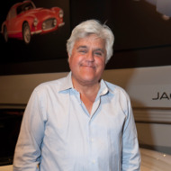 LOS ANGELES, CA - APRIL 09:  Comedian Jay Leno  attends the Worlds Greatest Sports Coupe exhibit opening celebration with Jaguar at the Petersen Automotive Museum on April 9, 2014 in Los Angeles, California.  (Photo by Angela Weiss/Getty Images for Petersen Automotive Museum)