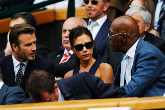 LONDON, ENGLAND - JULY 06:  David Beckham, Victoria Beckham and Samuel L Jackson in the Royal Box on Centre Court before the Gentlemen's Singles Final match between Roger Federer of Switzerland and Novak Djokovic of Serbia on day thirteen of the Wimbledon Lawn Tennis Championships at the All England Lawn Tennis and Croquet Club on July 6, 2014 in London, England.  (Photo by Pool/Getty Images)