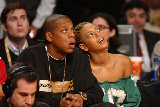 ATLANTA, GA - FEBRUARY 9:  Rapper Jay-Z and singer Beyonce Knowles watch the action during the 2003 NBA All-Star game at the Phillips Arena February 9, 2003 in Atlanta, Georgia.  (Photo by Vince Bucci/Getty Images)