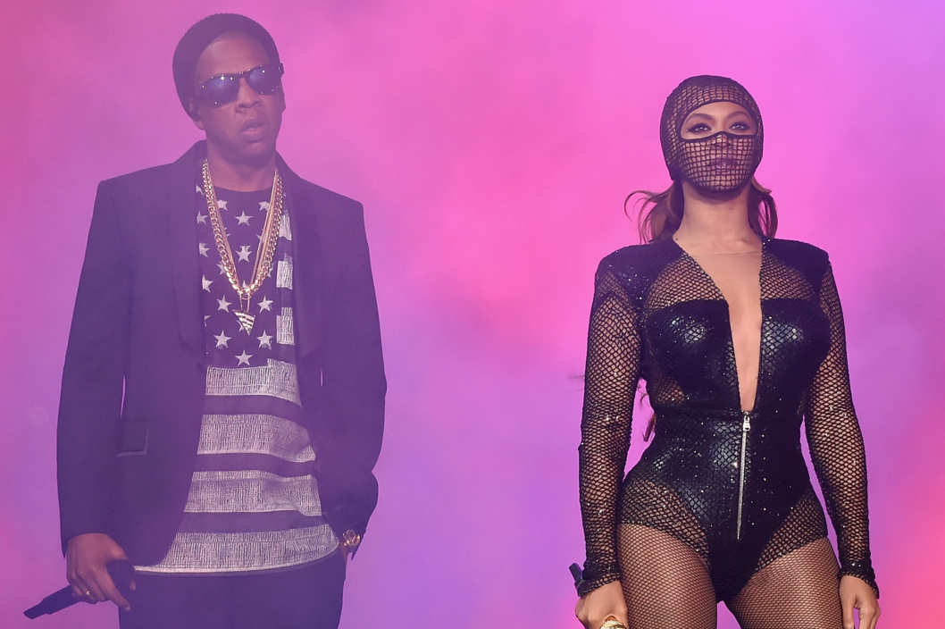 "CHICAGO, IL - JULY 24:  Jay-Z (L) and Beyonce perform onstage during the ""On The Run Tour: Beyonce And Jay-Z"" at Soldier Field on July 24, 2014 in Chicago, Illinois.  (Photo by Larry Busacca/PW/WireImage for Parkwood Entertainment)"