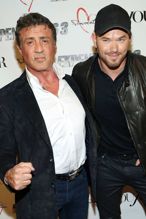 NEW YORK, NY - AUGUST 14: Actors Sylvester Stallone (L) and Kellan Lutz attend the DuJour Summer Cover Celebration With Sylvester Stallone at Provocateur on August 14, 2014 in New York City.  (Photo by Monica Schipper/FilmMagic)