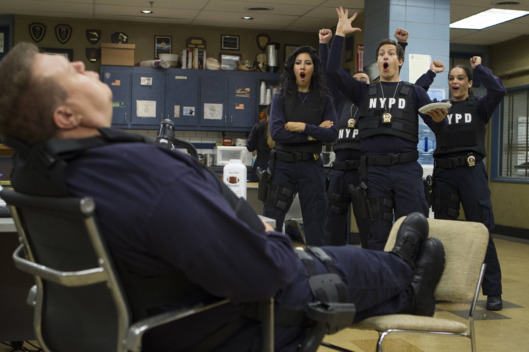 "BROOKLYN NINE-NINE: Detectives Diaz (Stephanie Beatriz, second from L), Peralta (Andy Samberg, third from L) and Santiago (Melissa Fumero, R) have fun with Scully (Joel Mckinnon MIller, L) in the ""Jimmy Jab Games"" episode of BROOKLYN NINE-NINE airing Sunday, Oct. 12 (8:30 - 9:00) PM ET/PT) on FOX. ?2014 Fox Braodcasting Co. CR: Eddy Chen/FOX"