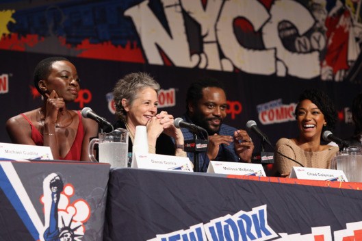 "NEW YORK, NY - OCTOBER 11:  Danai Gurira, Melissa McBride, Chad L. Coleman and Sonequa Martin-Green speak at ""The Walking Dead"" NY Comic Con Panel on October 11, 2014 in New York City.  (Photo by Robin Marchant/Getty Images for AMC)"