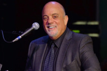 Billy Joel performs at SiriusXM's Town Hall with Billy Joel hosted by Howard Stern at The Cutting Room on April 28, 2014 in New York City.