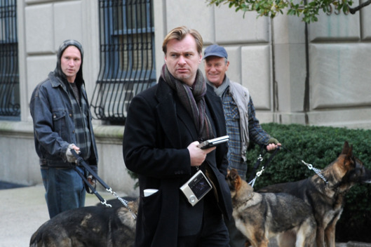 "NEW YORK, NY - NOVEMBER 02:  Director Christopher Nolan works on the set of ""Dark Knight Rises"" on the streets of Manhattan on November 2, 2011 in New York City.  (Photo by Bobby Bank/WireImage)"