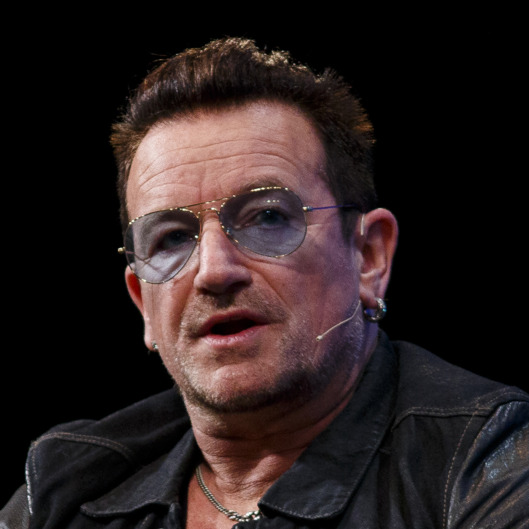 DUBLIN, IRELAND - NOVEMBER 06:  Bono joins Dana Brunetti; Eric Wahlforss and David Cart in a discussion on the Web Summit Centre Stage at the 2014 Web Summit on November 6, 2014 in Dublin, Ireland.  (Photo by Tristan Fewings/Getty Images)