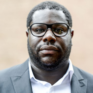 """WASHINGTON, DC - SEPTEMBER 25: Steve McQueen arrives at """"12 Years a Slave"""" Town Hall Discussion at Howard University on September 25, 2014 in Washington, DC. (Photo by Leigh Vogel/Getty Images)"""