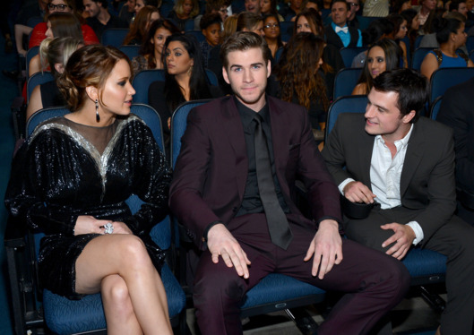 LOS ANGELES, CA - JANUARY 09:  (L-R) Actors Jennifer Lawrence, Liam Hemsworth and Josh Hutcherson attend the 39th Annual People's Choice Awards at Nokia Theatre L.A. Live on January 9, 2013 in Los Angeles, California.  (Photo by Frazer Harrison/Getty Images for PCA)