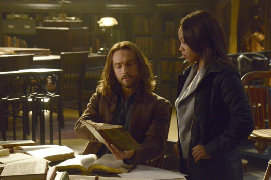 "SLEEPY HOLLOW: Ichabod (Tom Mison, L) and Abbie (Nicole Beharie, R) look for a dangerous book of spells in the ""Spellcaster"" episode of SLEEPY HOLLOW aiirng Monday, Feb. 2 (9:00-10:00 PM ET/PT) on FOX. ?2014 Fox Broadcasting Co. CR: Brownie Harris/FOX"