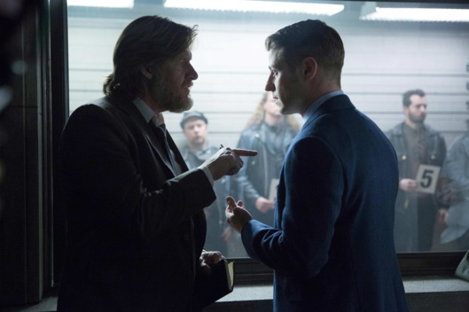 "Gordon (Ben McKenzie, R) and Bullock (Donal Logue, L) participate in a police line-up in the ""Red Hood"" episode of GOTHAM."