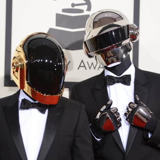 "Nominee For Best Album Of The Year ""Random Access Memories"" Daft Punk arrive on the red carpet for the 56th Grammy Awards at the Staples Center in Los Angeles, California, January 26, 2014."