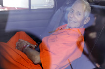 Robert Durst is transported from Orleans Parish Criminal District Court to the Orleans Parish Prison after his arraignment in New Orleans, Tuesday, March 17, 2015.  Durst was rebooked on charges of being a convicted felon in possession of a firearm, and possession of a weapon with a controlled dangerous substance, a small amount of marijuana. (AP Photo/Gerald Herbert)