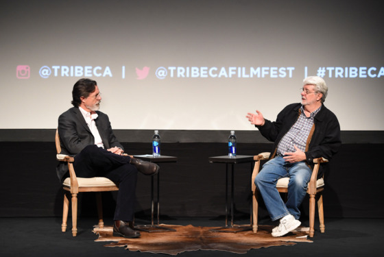 NEW YORK, NY - APRIL 17:  George Lucas (R) and Stephen Colbert speak onstage at Tribeca Talks: Director Series: George Lucas With Stephen Colbert during the 2015 Tribeca Film Festival at BMCC Tribeca PAC on April 17, 2015 in New York City.  (Photo by Jamie McCarthy/Getty Images for the 2015 Tribeca Film Festival )