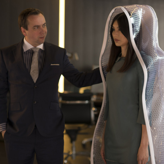 Dan Tetsell as Salesman and Gemma Chan as Anita - Humans _ Season 1, Episode 1 - Photo Credit: Des Willie/Kudos/AMC/C4