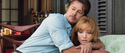 Roland (BRAD PITT) and Vanessa (ANGELINA JOLIE PITT) embrace in By the Sea, a dramatic film from director Jolie Pitt that follows an American writer and his wife who arrive in a tranquil and picturesque seaside resort in 1970s France, their marriage in apparent crisis.
