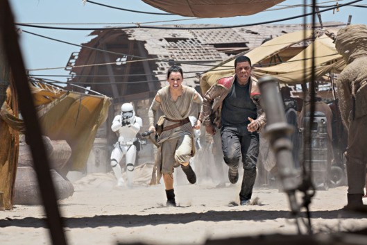 Star Wars: The Force Awakens. L to R: Rey (Daisy Ridley) and Finn (John Boyega).