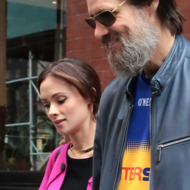 Jim Carrey and Cathriona White leave their hotel hand in hand