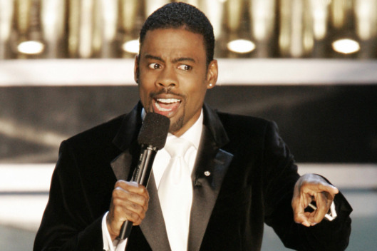 Comedian Chris Rock opens the 77th Acade