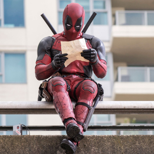 Ryan Reynolds as Deadpool relaxes before leaping into battle.