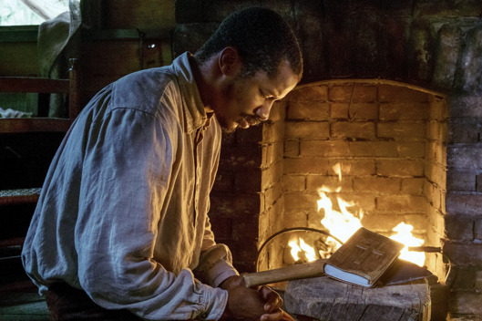 "Nate Parker as ""Nat Turner"" in THE BIRTH OF A NATION. Photo by Jahi Chikwendiu. © 2016 Twentieth Century Fox Film Corporation All Rights Reserved"