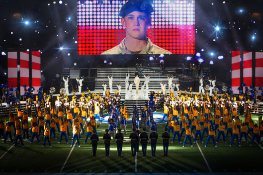 "This image released by Sony Pictures shows Joe Alwyn, portraying Billy Lynn, on a screen in a scene from the film, ""Billy Lynn's Long Halftime Walk,"" in theaters on November 11.  (Mary Cybulski/Sony-TriStar Pictures via AP)"