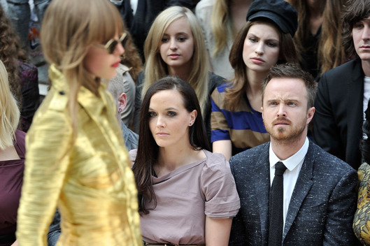 (L-R)  Victoria Pendleton and Aaron Paul, attend the Burberry Spring Summer 2013 Womenswear Show - Front Row at Kensington Gardens on September 17, 2012 in London, England.