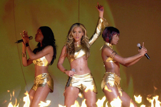 Original caption: Destiny's Child (L-R) Michelle Williams, Beyonce Knowles and Kelly Rowland perform during the Brit Awards at the Earls Court arena in London February 26, 2001. The Brit Awards are the British music industry's equivalent of the Grammys, the biggest and most revered music awards ceremony of the year.   REUTERS/POOL/John Stillwell --- Image by © Reuters/CORBIS