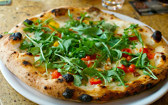 "<b>Ilaria</b>    <a href=""http://www.unapizza.com/sf/"">Una Pizza Napoletana</a>    <i>San Francisco</i>  Una Pizza Napoletana founder Anthony Mangieri does pizza like Fugazi's Ian MacKaye does music: Simple. Pure. And unfazed by any extraneous poser bullshit. And before shipping out to the West Coast, his very serious approach to America's most favorite fun food <a href=""http://nymag.com/restaurants/cheapeats/2009/57897/"">defined pizza perfection in New York's East Village</a>. In <a href=""http://sanfrancisco.grubstreet.com/2010/09/what_to_eat_at_una_pizza_napol.html"">San Francisco</a>, he continues his mission as the keeper of the wood-fired pizza flame."