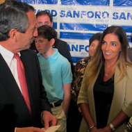 Former South Carolina Gov. Mark Sanford thanks his fiance Maria Belen Chapur as he addresses supporters in Mount Pleasant, S.C., on Tuesday, April 2, 2013, after winning the GOP nomination for the U.S. House seat he once held. Sanford is trying to make a comeback after his political career was derailed four years ago when he disappeared from the state only to return to admit the couple was having an affair. Sanford's wife, Jenny, later divorced him. (AP Photo/Bruce Smith)