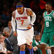 NEW YORK, NY - APRIL 20: Carmelo Anthony #7 of the New York Knicks celebrates a three point basket in the second half as Jeff Green #8 of the Boston Celtics looks on during Game One of the Eastern Conference Quarterfinals of the 2013 NBA Playoffs on April 20, 2013 at Madison Square Garden in New York City. The New York Knicks defeated the Boston Celtics 85-78. NOTE TO USER: User expressly acknowledges and agrees that, by downloading and/or using this photograph, user is consenting to the terms and conditions of the Getty Images License Agreement. (Photo by Elsa/Getty Images)