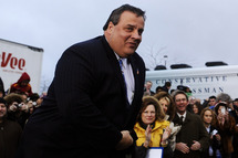 New Jersey Governor Chris Christie  looks on during a campaign rally outside a grocery store in Des Moines, Iowa, on December 30, 2011. Romney on Friday ripped President Barack Obama over his annual Hawaii vacation, painting him as out of touch with Americans' economic suffering.