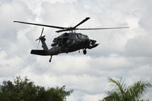 "An artillery helicopter type Black Hawk AH-60L ""Arpia"" of the Colombian Air Force flies over in Quibdo, Department of Choco, Colombia, on November 21, 2014. The government of Juan Manuel Santos expects the speedy release of Brigadier General Ruben Alzate, Cabo Jorge Rodriguez and lawyer Gloria Urrego captured Sunday in Choco (west), and soldiers Cesar Rivera and Jhonatan Diaz held prisoners since November 9 after fighting in the department of Arauca (eastern, border with Venezuela).  AFP PHOTO/LUIS ROBAYO        (Photo credit should read LUIS ROBAYO/AFP/Getty Images)"