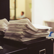 Stacks of papers on desk