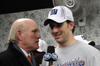 Eli Manning #10 of the New York Giants is interviewed in the locker room by Terry Bradshaw