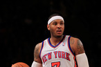 Carmelo Anthony #7 of the New York Knicks dribbles against the Charlotte Bobcats at Madison Square Garden on January 9, 2012 in New York City