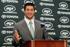 Quarterback Tim Tebow addresses the media as he is introduced as a New York Jet at the Atlantic Health Jets Training Center on March 26, 2012 in Florham Park, New Jersey.
