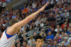 Jeremy Lin #17 of the New York Knicks drives around Spencer Hawes #00 of the Philadelphia 76ers