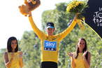 Bradley Wiggins of Great Britain and Sky Procycling receives the last yellow jersey during the trophy ceremony, after the twentieth and final stage of the 2012 Tour de France, from Rambouillet to the Champs-Elysees on July 22, 2012 in Paris, France