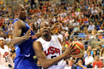 Kevin Durant #5 of the US Men's Senior National Team drives to the basket during a game against Serge Ibaka #14 of the Spanish Men's Senior National Team at Palau Sant Jordi on July 24, 2012