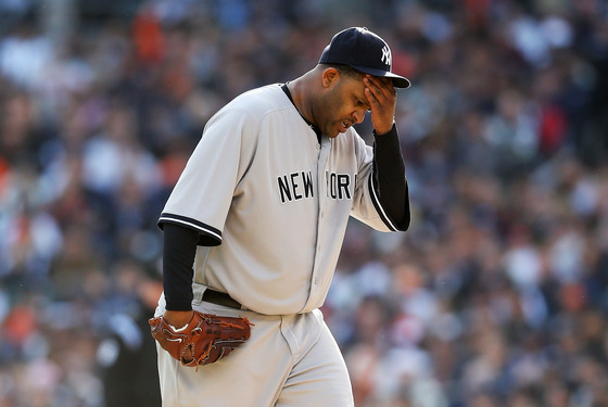 DETROIT, MI - OCTOBER 18: CC Sabathia #52 of the New York Yankees wipes his forehead with his hand against the Detroit Tigers during game four of the American League Championship Series at Comerica Park on October 18, 2012 in Detroit, Michigan. (Photo by Leon Halip/Getty Images)
