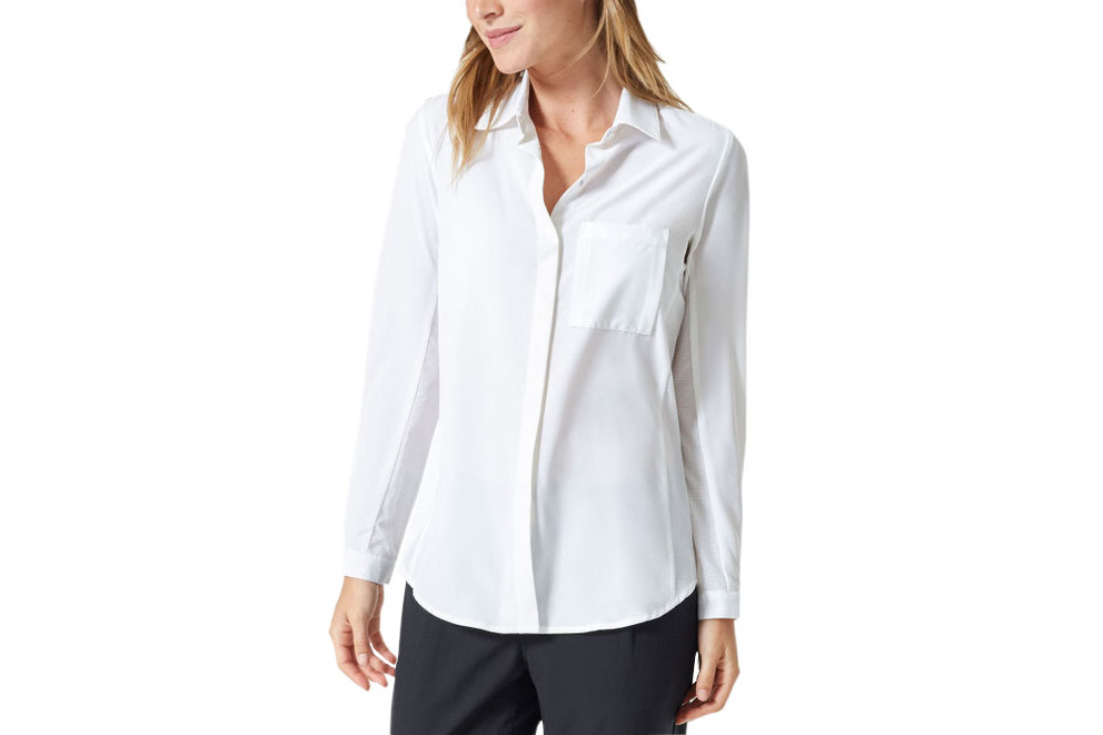 For example: the white button-down shirt. There's a reason this staple has so much staying power. It adds sophistication to an office wardrobe, and it goes with any pencil skirt, slacks, or jeans.